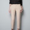 To get actress Keri Russell\'s look, try the trousers with studded waistband from Zara.com for $79.90. (Courtesy Zara.com via Los Angeles Times/MCT)