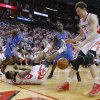 Houston\'s Omer Asik (3) goes for the ball as James Harden (13) hits the ground beside Oklahoma City\'s Serge Ibaka (9) and Reggie Jackson (15) during Game 3 in the first round of the NBA playoffs between the Oklahoma City Thunder and the Houston Rockets at the Toyota Center in Houston, Texas, Sat., April 27, 2013. Oklahoma City won 104-101. Photo by Bryan Terry, The Oklahoman