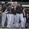 Photo - Texas Tech's Ryan Long (7) is met by Adam Kirsch (9) and Matt Withrow (35) after scoring on a single hit by Tim Proudfoot in the second inning against Miami during an NCAA college baseball regional tournament in Coral Gables, Fla., Saturday, May 31, 2014. (AP Photo/Lynne Sladky)
