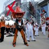 Photo - Pistol Pete entrains fans during a pep rally during the college football game between Oklahoma State University (OSU) and Florida State University (FSU) at the AdvoCare Cowboys Classic at At&T Stadium in Arlington, Texas,  Saturday, Aug. 30, 2014. Photo by Sarah Phipps, The Oklahoman