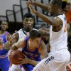 Photo - Oklahoma State's Marcus Smart, left, and Kamari Murphy defend Texas-Arlington's Drew Charles during a college basketball game between Oklahoma State University and UT Arlington at Gallagher-Iba Arena in Stillwater, Okla., Wednesday, Dec. 19, 2012. Photo by Bryan Terry, The Oklahoman