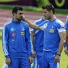 Greece\'s Costas Katsouranis, right, jokes with Yannis Maniatis during a training session at the Euro 2012 soccer championship in Legionowo about 25 kilometers (15 miles) north of Warsaw, Poland on Monday, June 18, 2012. (AP Photo/Thanassis Stavrakis)