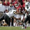 Baylor\'s Darius Jones (7) and Ahmad Dixon (6) go after Oklahoma\'s Jalen Saunders (18) during the college football game between the University of Oklahoma Sooners (OU) and Baylor University Bears (BU) at Gaylord Family - Oklahoma Memorial Stadium on Saturday, Nov. 10, 2012, in Norman, Okla. Photo by Chris Landsberger, The Oklahoman