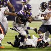 Minnesota Vikings running back Adrian Peterson (28) rushes between Chicago Bears\' Nate Collins, left, and Lance Briggs, right, during the second half of an NFL football game, Sunday, Dec. 9, 2012, in Minneapolis. The Vikings won 21-14. (AP Photo/Andy King)