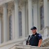 A Capitol Hill police officer stands guard on Capitol Hill in Washington, Friday, Oct. 4, 2013, a day after a Connecticut woman was shot to death outside the Capitol after trying to ram her car through a White House barrier. (AP Photo/ Evan Vucci) ORG XMIT: DCEV113