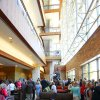 Guests gather in the atrium of the Peggy and Charles Stephenson Oklahoma Cancer Center on Thursday after a dedication ceremony. The building is open for tours from 9 a.m. to 3:30 p.m. Friday. Photo by David McDaniel, The Oklahoman ORG XMIT: KOD David McDaniel - The Oklahoman