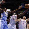 Oklahoma City\'s Kendrick Perkins (5) grabs a rebound between Denver\'s Kenneth Faried (35) and Oklahoma City\'s Nick Collison (4) during an NBA basketball game between the Oklahoma City Thunder and the Denver Nuggets at Chesapeake Energy Arena in Oklahoma City, Tuesday, March 19, 2013. Denver won 114-104. Photo by Bryan Terry, The Oklahoman