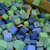 Kane Barton, of Oklahoma City, is covered in foam cubes as he falls into a pit at Mat Trotters Gymnastics in Oklahoma City on Wednesday, July 27, 2011. Oklahomans Without Limits (OWL) is a summer camp for kids who are blind or visually impaired. The camp pairs each visually impaired child with a sighted buddy for the week long camp. Photo by John Clanton, The Oklahoman