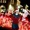 2004: Chelsea Agee of Edmond walks beside a float for X-Treme Cheer and Dance during the Parade of Lights in Edmond, Okla., Dec. 1, 2004. By Bryan Terry/The Oklahoman