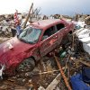 Homes and automobiles damaged by Monday\'s tornado are seen by early morning light near Telephone road and SW 4th Street on Tuesday, May 21, 2013 in Moore, Okla. Photo by Steve Sisney, The Oklahoman
