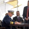 Photo - Admiral Robert J. Papp, Jr., Commandant of the United States Coast Guard signs the deed transfer from the City of New London, Conn., to the Coast Guard for the National Coast Guard Museum during a ceremony at the City Pier Stage on Waterfront Park in New London Friday May 2, 2014.  (AP Photo/The Day, Tim Cook)