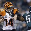 Cincinnati Bengals\' Andy Dalton, left, tries to break free from Philadelphia Eagles\' Brandon Graham in the second half of an NFL football game, Thursday, Dec. 13, 2012, in Philadelphia. (AP Photo/Matt Rourke)