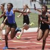 Deer Creek\'s Kirsten Burnett takes the handoff from teammate Jessie Heiden to win the girl\'s 5A 4 X 100 relay during the 5A and 6A State Track Meet in Yukon, OK, Saturday, May 11, 2013, By Paul Hellstern, The Oklahoman