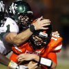 Timberwolf Daniel Davis (1) tackles quarterback Zach Long (16) as Norman High plays Norman North at Harve Collins Field on Friday Sept. 3, 2010, in Norman, Okla. Photo by Steve Sisney, The Oklahoman