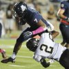 Photo - Allen linebacker Tay Evans (7) runs for a first quarter touchdown over Plano East defensive back Ahmad Muhammad (2) during a Class 5A high school football game, Friday, Oct. 11, 2013 at Eagle Stadium in Allen, Texas.  (Matt Strasen/Special Contributor)