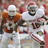 Oklahoma\'s Jaz Reynolds (16) catches a pass in front of Texas\' Jackson Jeffcoat (44) during the Red River Rivalry college football game between the University of Oklahoma Sooners (OU) and the University of Texas Longhorns (UT) at the Cotton Bowl in Dallas, Saturday, Oct. 8, 2011. Photo by Chris Landsberger, The Oklahoman