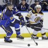 Photo - St. Louis Blues' Kevin Shattenkirk, left, and Boston Bruins' Brad Marchand chase after a loose puck during the second period of an NHL hockey game Thursday, Feb. 6, 2014, in St. Louis. (AP Photo/Jeff Roberson)
