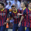 Photo - FC Barcelona's Alexis Sanchez, second left, celebrates after scoring against Getafe with his teammates Xavi Hernandez, left, Andres Iniesta, second right, and Lionel Messi from Argentina, during a Spanish La Liga soccer match at the Camp Nou stadium in Barcelona, Spain, Saturday May 3, 2014. (AP Photo/Manu Fernandez)
