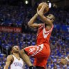 Houston\'s James Harden (13) drives to the basket past Oklahoma City\'s Russell Westbrook (0) during Game 1 in the first round of the NBA playoffs between the Oklahoma City Thunder and the Houston Rockets at Chesapeake Energy Arena in Oklahoma City, Sunday, April 21, 2013. Photo by Nate Billings, The Oklahoman
