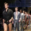 Models wear creations of Versace from the men\'s Spring-Summer 2013 collection, part of the Milan Fashion Week, unveiled in Milan, Italy, Saturday, June 23, 2012. (AP Photo/Luca Bruno)