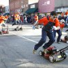 The OSU Lawnmower Drill Team performs in the Oklahoma State Cowboy\'s homecoming parade in downtown Stillwater, OK, Saturday, Oct. 29, 2011. By Paul Hellstern, The Oklahoman