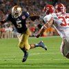 Photo - Notre Dame quarterback Everett Golson (5) runs past Alabama's Xzavier Dickson (47) and Trey DePriest (33) for a touchdown during the second half of the BCS National Championship college football game Monday, Jan. 7, 2013, in Miami. (AP Photo/Wilfredo Lee)