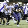 NOAH #73 Cole Roberts reaches for Barry Sanders, Jr. as he goes by on his way to his first touchdown of the night during the high school football game between Heritage Hall and NOAH in Oklahoma City, Friday, Oct. 1, 2010. Photo by Doug Hoke, The Oklahoman.