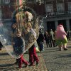 Photo - People looks at a bubble breaking in the air as artists perform for money in Madrid, Sunday, Jan. 6, 2013. The number of people registered as unemployed in Spain has gone down, bringing some cheer as the country looks to emerge from recession in 2013. Figures released Thursday showed the registered jobless figure dropped by 59,094 in December compared to November, making for a rounded total of 4.8 million people listed as unemployed. (AP Photo/Andres Kudacki)