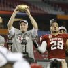 Oklahoma\'s Landry Jones (12) and Oklahoma\'s Travis Lewis (28) celebrate after the Fiesta Bowl college football game between the University of Oklahoma Sooners and the University of Connecticut Huskies in Glendale, Ariz., at the University of Phoenix Stadium on Saturday, Jan. 1, 2011. Photo by Bryan Terry, The Oklahoman