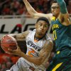 Oklahoma State\'s Le\'Bryan Nash (2) goes past Isaiah Austin (21) during an NCAA college basketball game between Oklahoma State University (OSU) and Baylor at Gallagher-Iba Arena in Stillwater, Okla., Saturday, Feb. 1, 2014. Baylor won 76-70. Photo by Bryan Terry, The Oklahoman