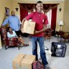 Laurence Greene, right, with his parents Lisa and Emmitt Greene in Edmond, Okla., home on Wednesday, July 16, 2009. For YOU! Story about saying farewell to students heading off to college. Photo by Bryan Terry, The Oklahoman