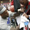 LeBron James signs a jersey for D.J. Sims, of Lawton, Okla., during the US Fleet Tracking Basketball Invitational at the Cox Convention Center in Oklahoma City Sunday, Oct. 23, 2011. Photo by John Clanton, The Oklahoman
