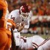 OU quarterback Sam Bradford rushes for a touchdown during the second half of the college football game between the University of Oklahoma Sooners (OU) and Oklahoma State University Cowboys (OSU) at Boone Pickens Stadium on Saturday, Nov. 29, 2008, in Stillwater, Okla. STAFF PHOTO BY SARAH PHIPPS