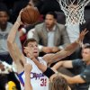 Los Angeles Clippers power forward Blake Griffin, left, goes up for a shot as Utah Jazz small forward Andrei Kirilenko defends during the first half of their preseason NBA basketball game, Saturday, Oct. 16, 2010, in Los Angeles. (AP Photo/Mark J. Terrill)