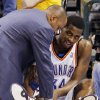 Photo - INJURY: Oklahoma City's Desmond Mason has his leg examined after being injured in the third quarter of the NBA basketball game between the Oklahoma City Thunder and the Memphis Grizzlies at the Ford Center in Oklahoma City, Wednesday, January 28, 2009. The Thunder won in overtime, 114-102. BY NATE BILLINGS, THE OKLAHOMAN ORG XMIT: KOD