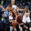 Photo - Boston College forward Kat Cooper drives the lane as Notre Dame forward Natalie Achonwa defends in the first half of an NCAA college basketball game, Thursday, Jan. 9, 2014 in South Bend, Ind. (AP Photo/Joe Raymond)