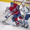 Photo - Montreal Canadiens' Daniel Briere is sandwiched between Toronto Maple Leafs goaltender Jonathan Bernier, left, and Toronto's Carl Gunnarsson during the second period of an NHL hockey game in Montreal, Saturday, March 1, 2014. (AP Photo/The Canadian Press, Graham Hughes)
