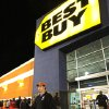 Tyler Harless of Byram, Miss., leaves a Jackson, Miss., Best Buy store after making Black Friday purchases early Nov. 23, 2012. A number of national retailers, have pushed the start of the holiday buying season with sales starting on Thanksgiving Day. (AP Photo/Rogelio V. Solis)