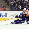 Toronto Maple Leafs\' James van Riemsdyk (21) battles for the puck with Philadelphia Flyers\' Braydon Coburn during the second period of their NHL hockey game, Monday, Feb. 11, 2013, in Toronto. (AP Photo/The Canadian Press, Chris Young)