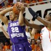 OSU\'s Toni Young (15) ties up the ball against James Madison\'s Tarik Hislop (22) during the Women\'s NIT championship college basketball game between Oklahoma State University and James Madison at Gallagher-Iba Arena in Stillwater, Okla., Saturday, March 31, 2012. Photo by Nate Billings, The Oklahoman