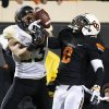 Photo - Oklahoma State safety Daytawion Lowe (8) breaks up a pass intended for Baylor wide receiver Clay Fuller (23) in the second quarter of an NCAA college football game in Stillwater, Okla., Saturday, Nov. 23, 2013. (AP Photo/Sue Ogrocki)