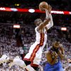 Miami\'s Dwyane Wade (3) shoots over Oklahoma City\'s James Harden (13) as Harden is called for a foul during Game 4 of the NBA Finals between the Oklahoma City Thunder and the Miami Heat at American Airlines Arena, Tuesday, June 19, 2012. Photo by Bryan Terry, The Oklahoman
