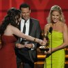 Kat Dennings, left, and Jon Cryer, center, present the award for outstanding supporting actress in a comedy series to Julie Bowen for
