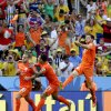 Photo - Netherlands' Wesley Sneijder (10) celebrates with teammates Memphis Depay and Klaas-Jan Huntelaar (19) after scoring his side's first goal during the World Cup round of 16 soccer match between the Netherlands and Mexico at the Arena Castelao in Fortaleza, Brazil, Sunday, June 29, 2014. (AP Photo/Felipe Dana)