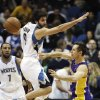 Minnesota Timberwolves\' Ricky Rubio, left, of Spain, goes high to defend but Los Angeles Lakers\' Steve Nash gets off a pass in the first quarter of an NBA basketball game, Friday, Feb. 1, 2013, in Minneapolis. (AP Photo/Jim Mone)