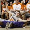 Kansas State\'s Jamar Samuels (32) looks to pass around Oklahoma State\'s Keiton Page (12) during an NCAA college basketball game between the Oklahoma State University Cowboys (OSU) and the Kansas State University Wildcats (KSU) at Gallagher-Iba Arena in Stillwater, Okla., Saturday, Jan. 21, 2012. Photo by Bryan Terry, The Oklahoman