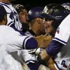 Photo - TCU teammates swarm Boomer White following his walkoff single against Siena in an NCAA college baseball regional tournament game in Fort Worth, Texas, Friday, May 30, 2014. TCU won in eleven innings 2-1. (AP Photo/Jim Cowsert)