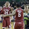 Oklahoma guard Je\'lon Hornbeak (5) heads over to celebrate with teammate Buddy Hield (24) as Baylor guard Brady Heslip (5) walks off the court after an NCAA college basketball game Saturday, Jan. 18, 2014, in Waco, Texas. Oklahoma won 66-64. (AP Photo/LM Otero)