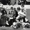 OU\'s Charles Thompson leaps over OSU\'s Mike Clark on his way to the winning touchdown in the fourth quarter of the Bedlam college football game on Nov. 5, 1988. Staff photo by David McDaniel