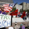 FILE - In this Oct. 6, 2011 file photo, Carol Gay, of Brick, N.J., holds a sign saying
